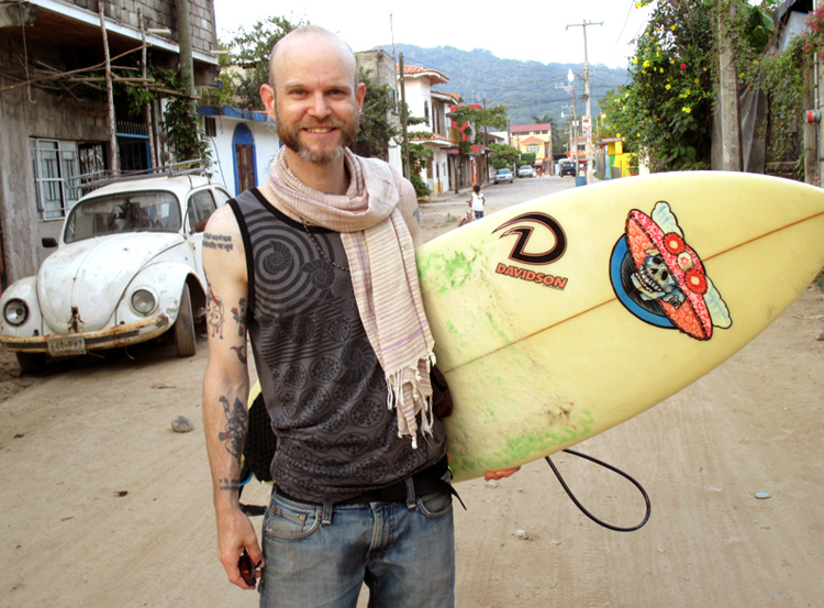 JPM with Surfboard in Lo de Marcos, Mexico - Vegan Cooking Adventures