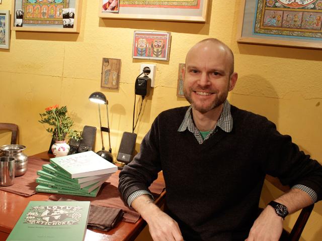 Vegan Cookbook Kickstarter - JPM in the kitchen with books